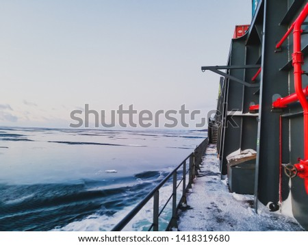 The sea in winter from the cockpit of a transport vessel and icebreaking vessel with ice and snow #1418319680