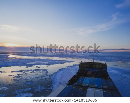 The sea in winter from the cockpit of a transport vessel and icebreaking vessel with ice and snow #1418319686
