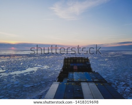 The sea in winter from the cockpit of a transport vessel and icebreaking vessel with ice and snow #1418319698