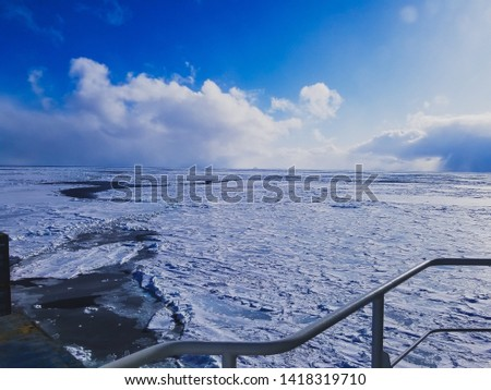The sea in winter from the cockpit of a transport vessel and icebreaking vessel with ice and snow #1418319710