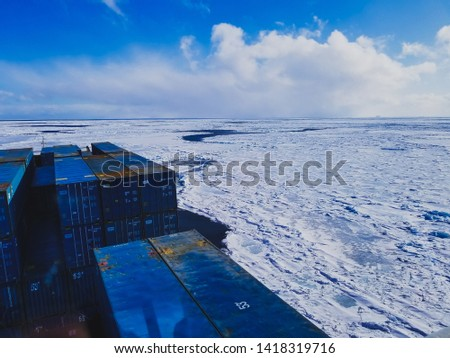 The sea in winter from the cockpit of a transport vessel and icebreaking vessel with ice and snow #1418319716