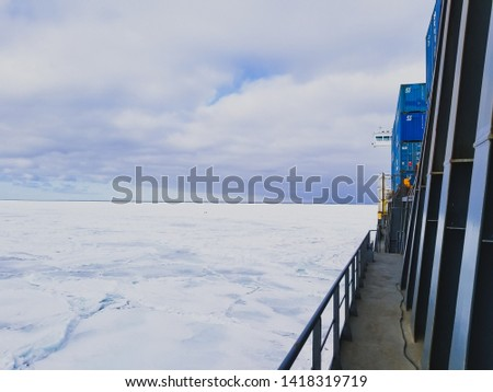 The sea in winter from the cockpit of a transport vessel and icebreaking vessel with ice and snow #1418319719