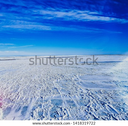The sea in winter from the cockpit of a transport vessel and icebreaking vessel with ice and snow #1418319722