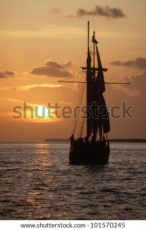 The Sea Wolf ship silhouetted at sunset on a cruise in Key West, Florida