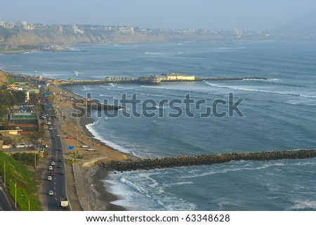 The seaside road in Miraflores, with a view on the coastline of Southern Lima in the usual misty weather. The surf breaks are used by many tourists and locals for surfing