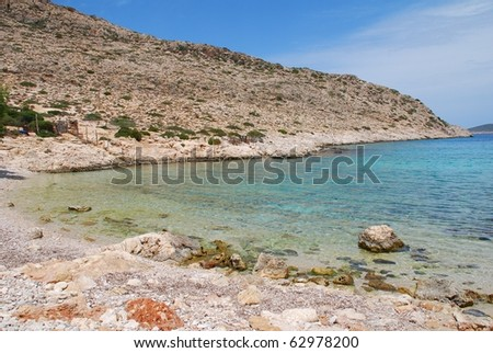 The secluded pebble beach at Kania on the Greek island of Halki.