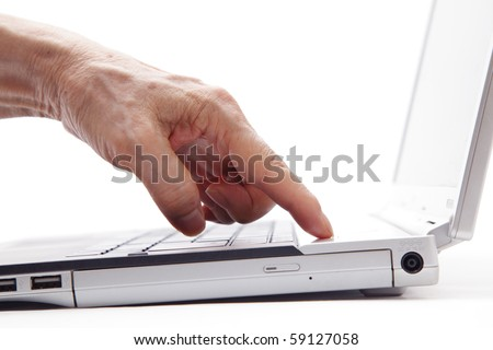 The senior hand presses the power button