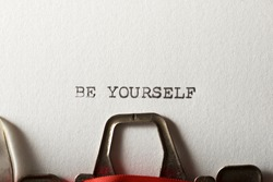 The sentence, Be yourself, written with a typewriter.