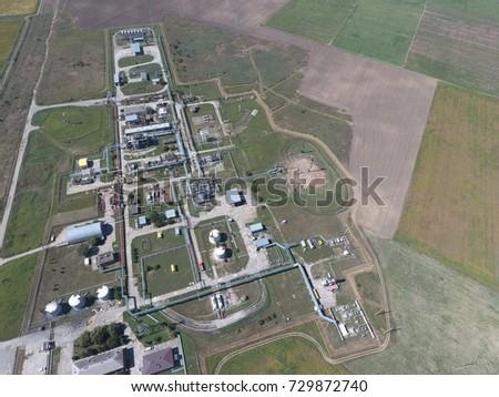 The separation system, top view. Aerophotographing station separation and dehydration of oil and gas. Equipment for the preparation and compression of gas, bird's eye view. #729872740