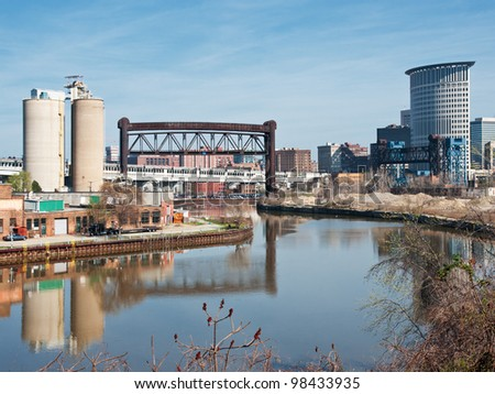 The serpentine Cuyahoga River winds through the heart of the city of Cleveland, Ohio out to Lake Erie with commerce, industry,drawbridges, silos, seen along her shoreline
