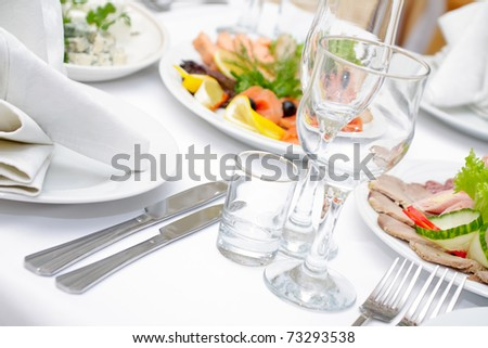 The served dinner table in a restaurant.