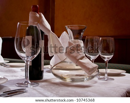 The served table with red wine at restaurant