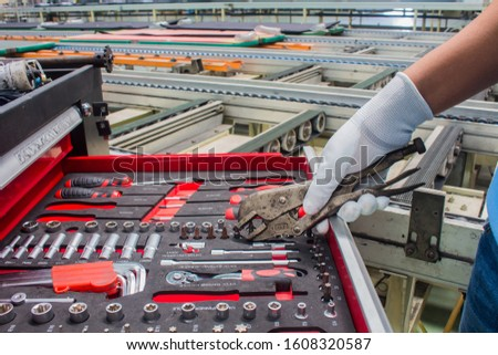 The set of hand tools for to repair. Many wrench and tools close-up in box for to repair the conveyor and car or replace automotive spare parts, auto parts