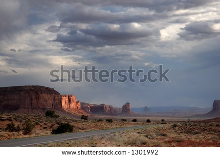 The setting sun and storm clouds above Monument Valley, Arizona, USA.