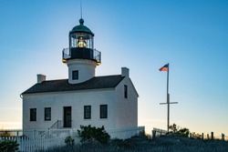 The setting sun illuminates the beacon at the Point Loma Lighthouse at the Cabrillo National Monument in San Diego
