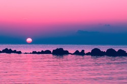 The setting sun sets over the horizon to the sea, Koh Phangan, Thailand