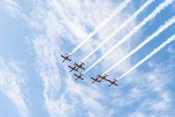 The seven fighting jets flying in the sky
