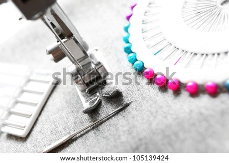 The sewing machine and needles.