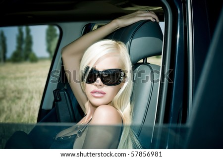 The sexual blonde in underwear in car salon