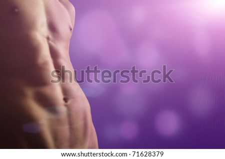 The sexual man's, tightened body on a beautiful background - stock photo