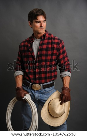 The sexy cowboy man awaits his cowgirl