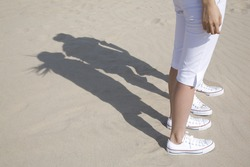 The shadow of couple on the beach