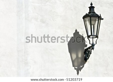 The shadow of Prague's ancient lamps