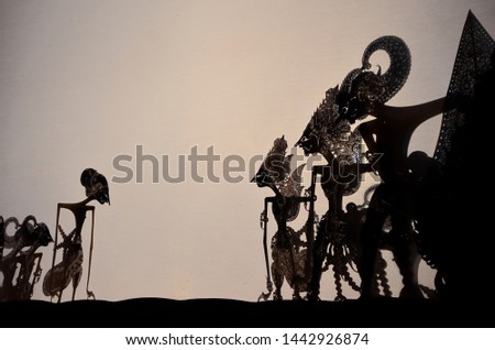 the shadow of the shadow puppet show from Yogyakarta Indonesia