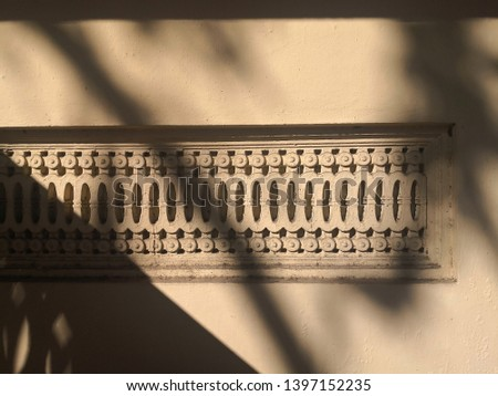 The shadow of the tree hits the building.Texture of Stucco,art stucco ,abstract classical style interior. BKK-Thailand #1397152235