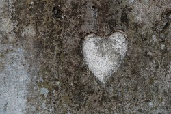 The shape of a heart on a old concrete wall