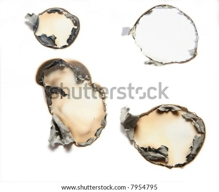 the sheet of paper with the burnt holes against the white background