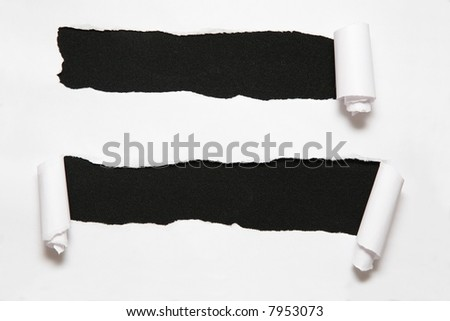 the sheet of paper with two holes against the black background