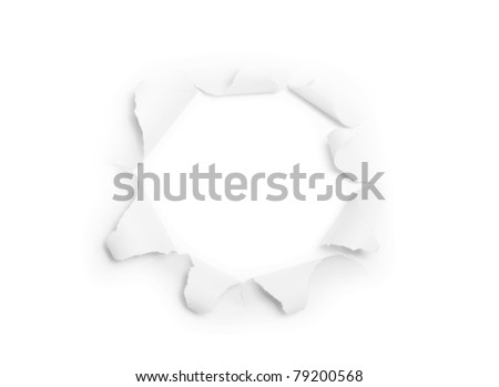 The sheet of torn paper with round hole isolated on white background