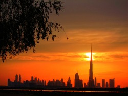 The Sheikh Zayed Road skyline in Dubai at sunset.