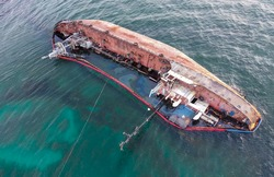 The ship ran aground and capsized, spilling oil into the sea. Ecological catastrophe on the coast. Environmental pollution.