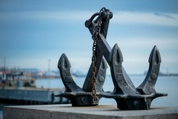 The ship's anchor stands on a pedestal, symbolizing the seafaring as well as the courage of sailors in the Second World War. High quality photo