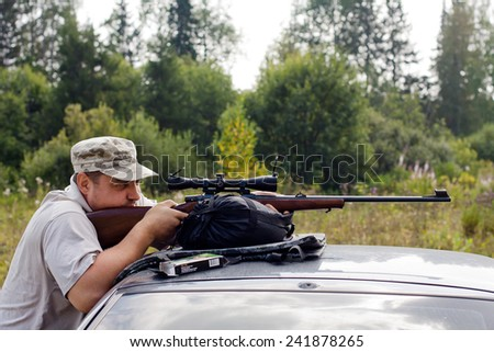 the shooter aiming from a rifle