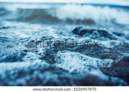 The shore, the blue sea, toned. #1026907870
