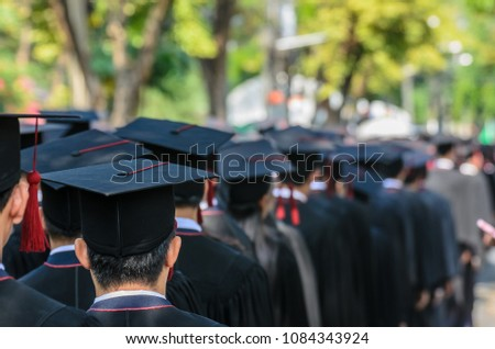 The shot of graduation hats and the back of graduates during commencement success graduates of the university in the Graduation Ceremony. Concept education congratulation of graduates in University.
