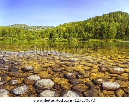 The shot of opposite shore of Lebed river in Turochak village (Russia, Altai Republic)