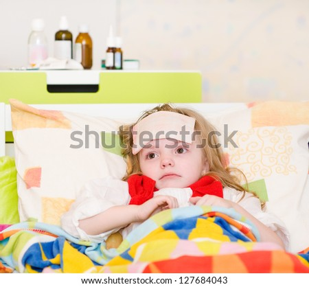 the sick child lies on a bed