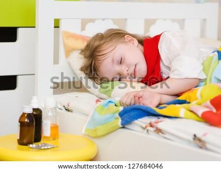 the sick child sleeps on a bed
