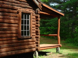 the side and porch on a log cabin