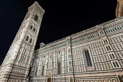 The side facade of the Florence Cathedral, Duomo of Santa Maria del Fiore and bell tower of Giotto di Bondone (Campanile). UNESCO world heritage site, Piazza del Duomo, Tuscany, Italy, Europe.