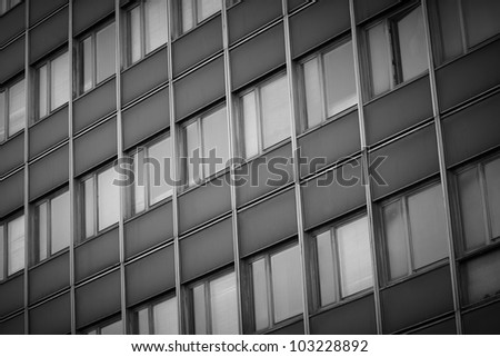 The side of an school building with many windows - stock photo