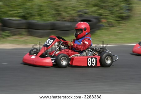 The side view of a red go kart
