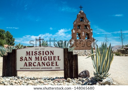 The sign and campanario at Mission San Miguel Arcangel in San Miguel, California along the historic mission trail.
