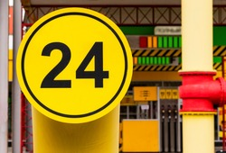 The sign are open round the clock. Automobile gas station works without interruption. open twenty four hour