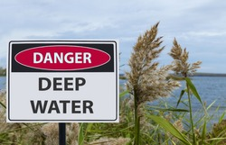 the sign danger deep water on the shore of the reservoir