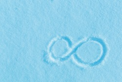 The sign of infinity on the snow. Blue snow, frosty morning